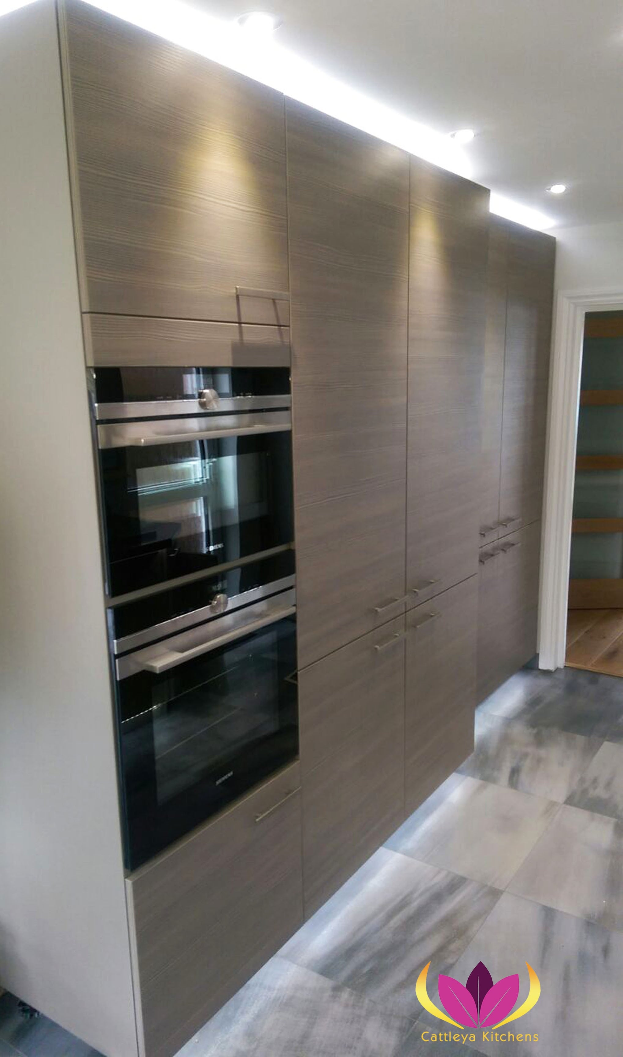Brown Tall cabinet units Ealing Finished Kitchen Project