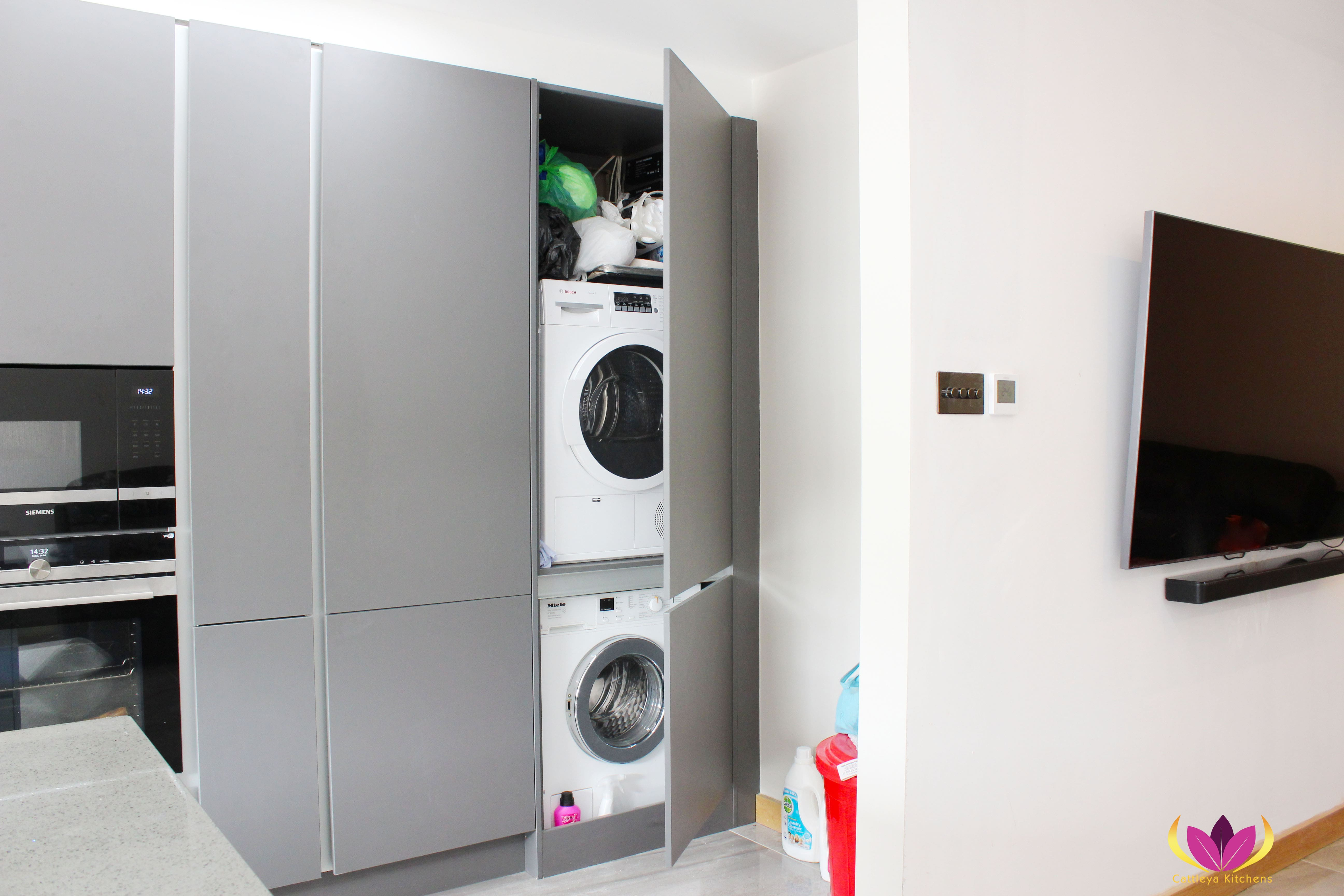 Washing machine inside gray cabinet Perivale Finished Kitchen Project