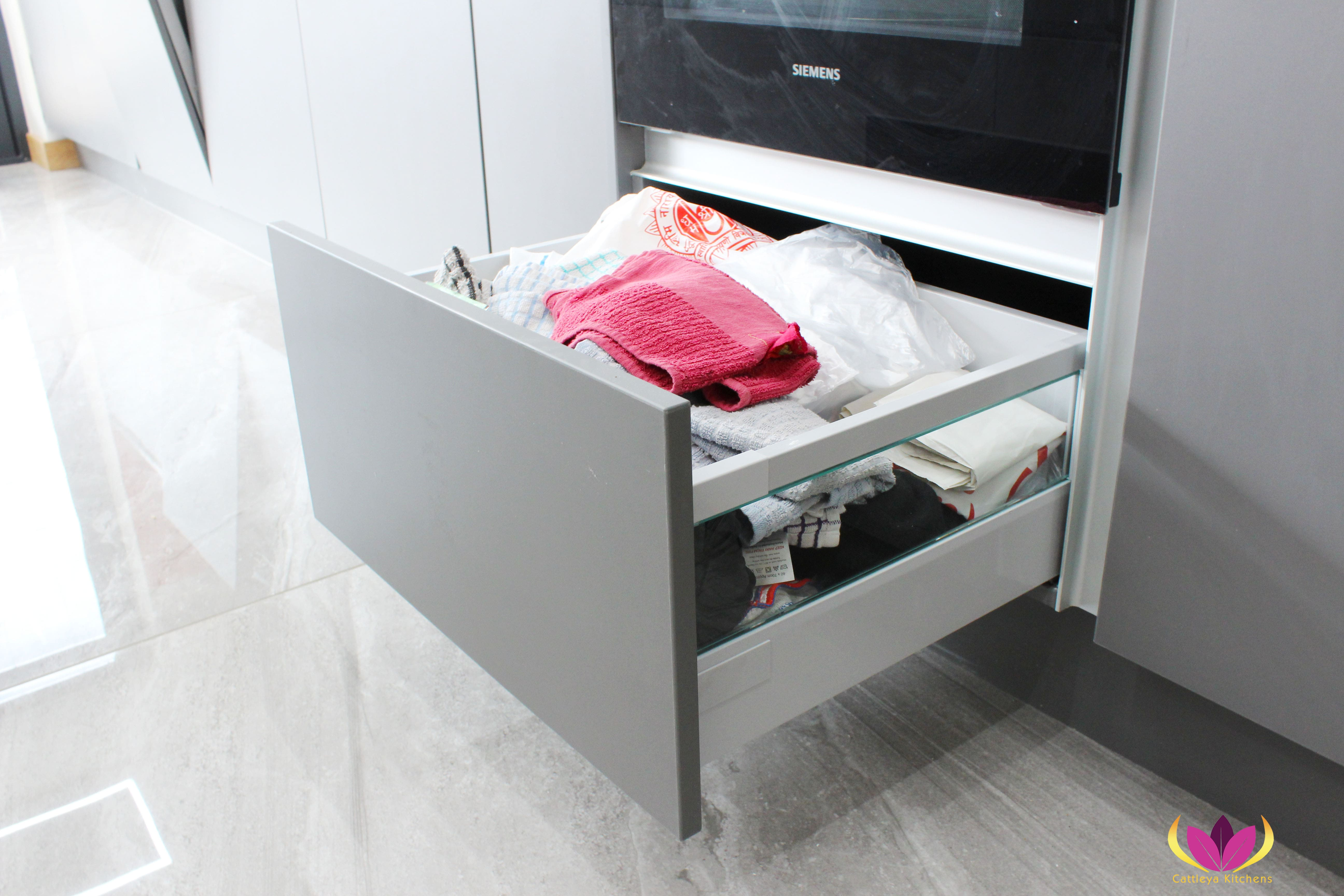Gray drawers with glass side panel Perivale Finished Kitchen Project