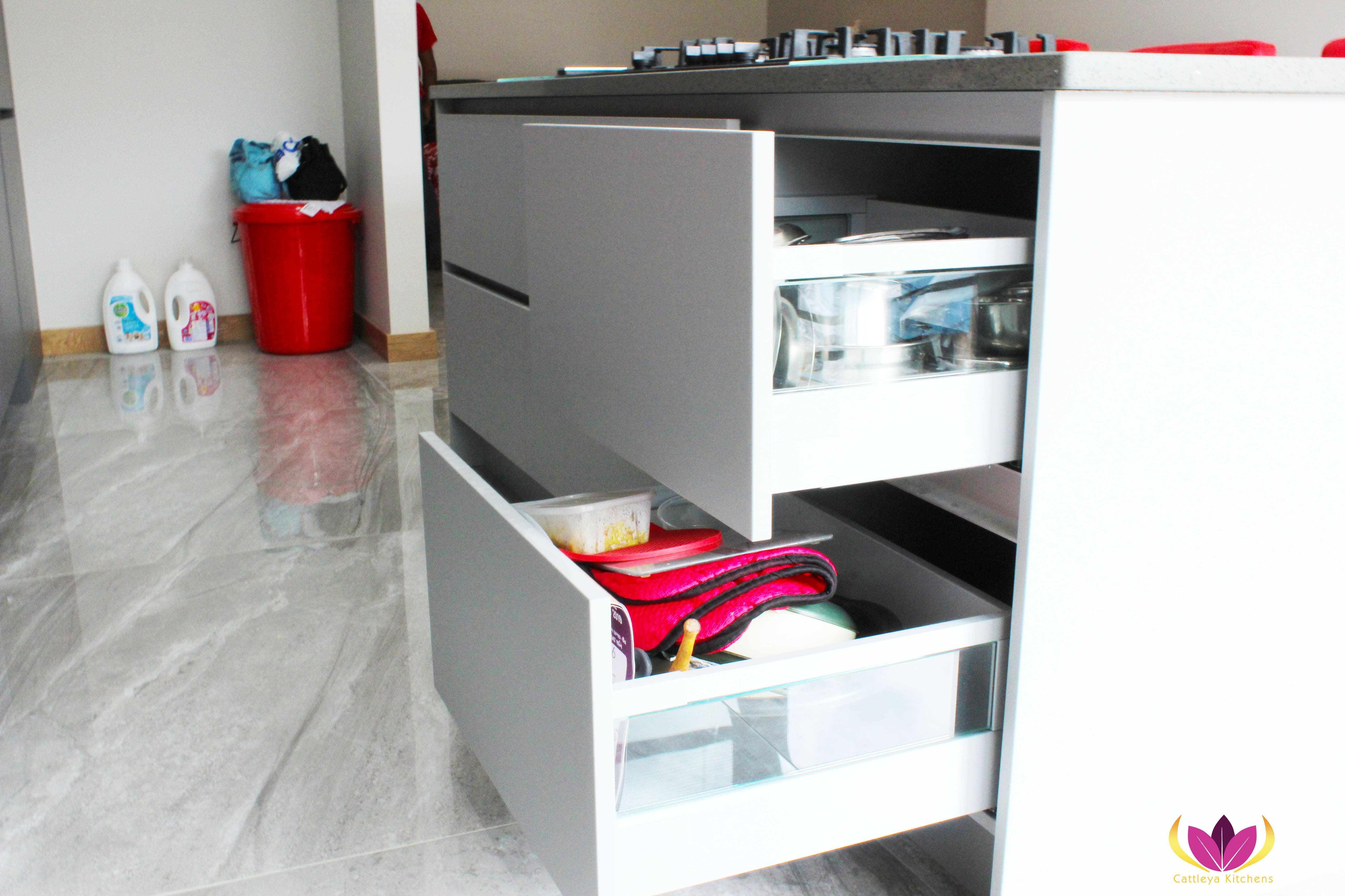 A closer look of drawers with glass side panel - Gray & Gloss Red Perivale Finished Kitchen Project