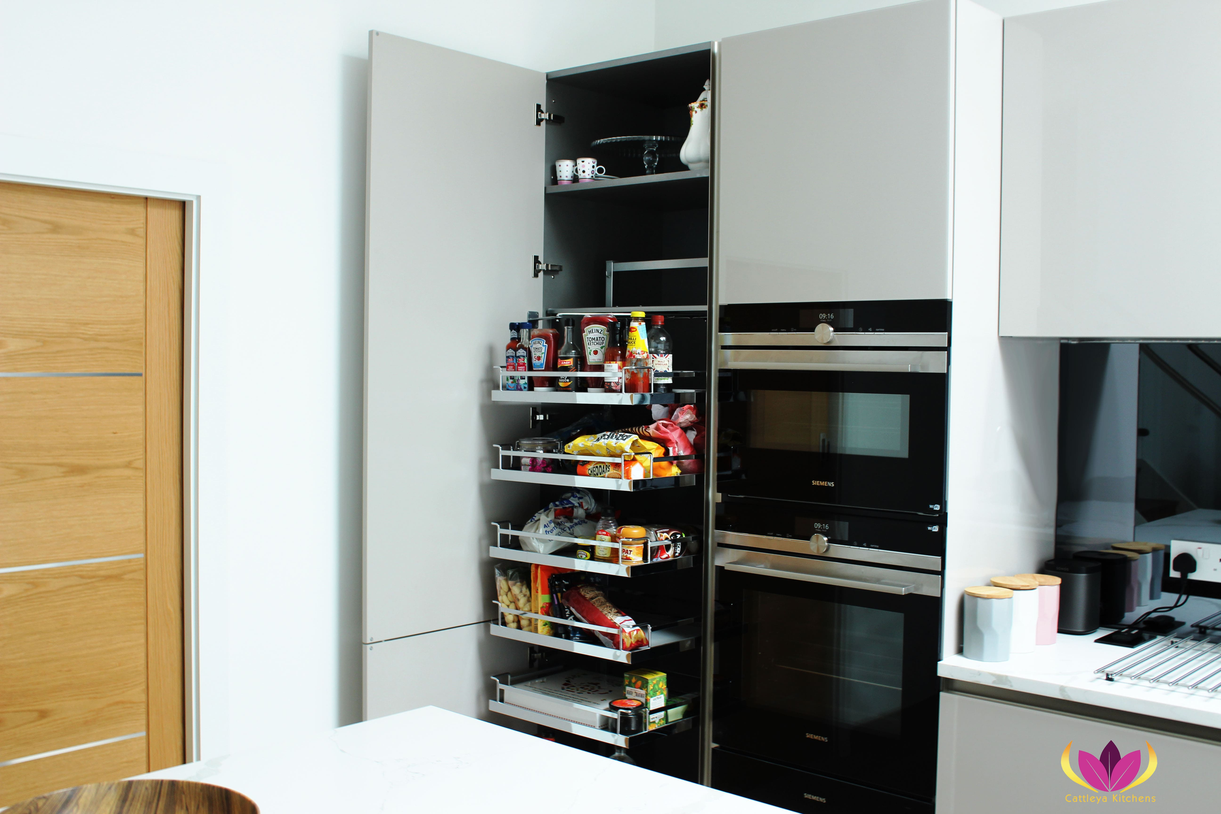 Inside tall cabinet units integrated with sliding metal fittings - Greenford Finished Kitchen Project