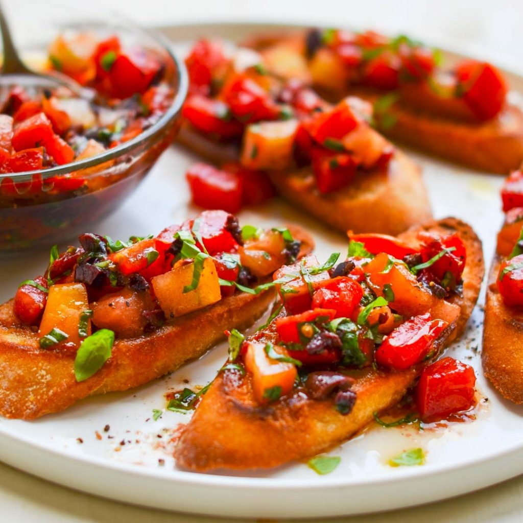 Bruschetta with Heirloom Tomatoes, Olives, and Basil